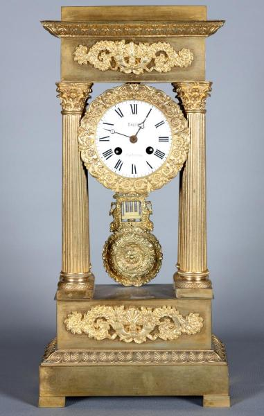 Empire period clock, 19th, gilded bronze